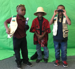 Picture of three 1st grade students in safari gear